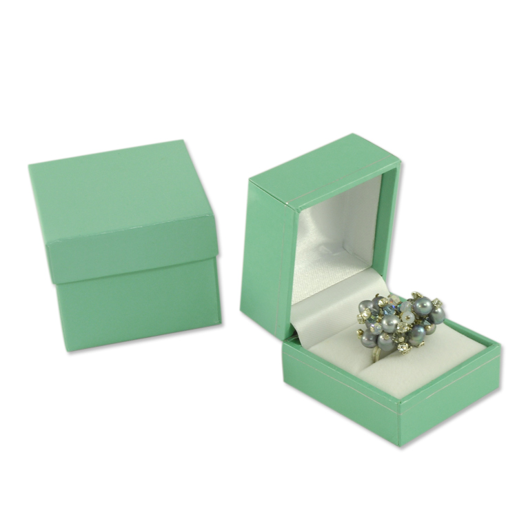 blue color jewelers ring box in teal single ring box